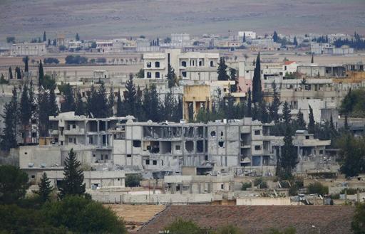 2014-10-20T051215Z_1007180001_LYNXNPEA9J04N_RTROPTP_3_OFRTP-SYRIE-ISLAMISTES-KOBANI-PARACHUTAGES